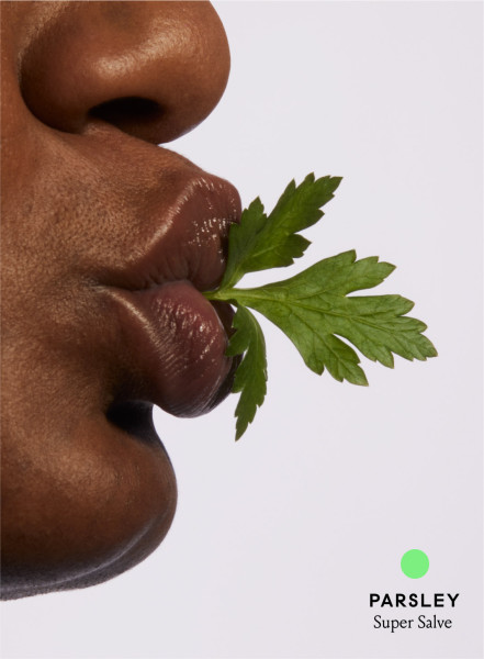 model in profile with a Parsley leaf coming out of their mouth