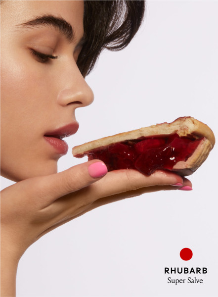 model holding a slice of Rhubarb pie.